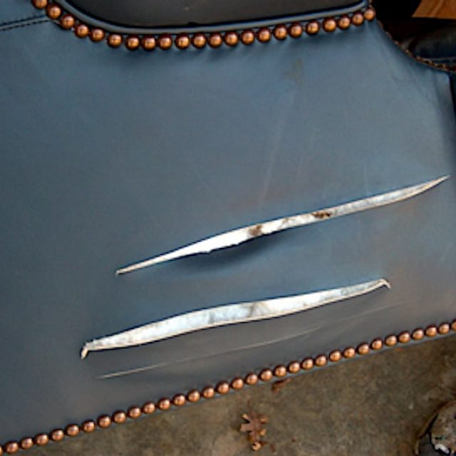 Knife Cuts in Leather